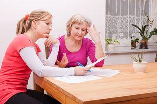 Bigstock-Two-Women-Pondering-Over-Docum-44621401