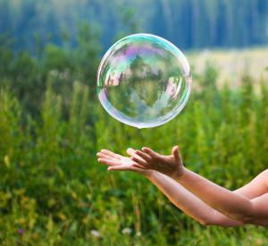 Bigstock-hand-catching-a-soap-bubble-26919833-300x275