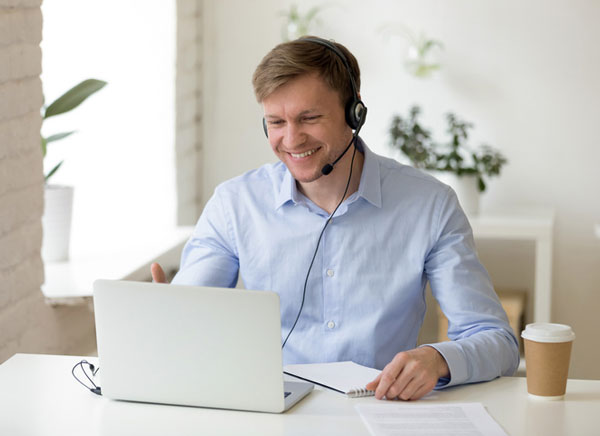 Businessman using headseat while on a conference call with a client